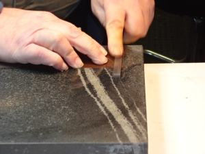 Deburring after milling to width
