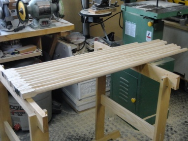"""I did it! After way too many hours, I managed to achieve the calculated yield out of the 7.4bf, 39 – 7"""" dog blanks, 1.9bf of finished material. Now they go to Chris for manufacturing, finishing and inspection. We usually loose another 10 – 15% by the time we are shipping the final product."""